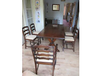 1940's, Dark oak refectory table, 4 chairs and 2 carvers. From Webber of Croydon.