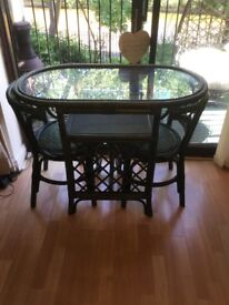 Glass Top/Wooden Table And Two Chairs With Two Cushions.