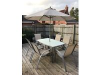 Patio Set including 6 chairs, parasol and side table