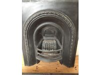 Genuine cast-iron fireplace insert and hearth surround