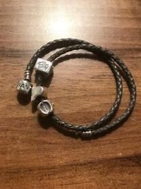 Leather pandora bracelet and three charms