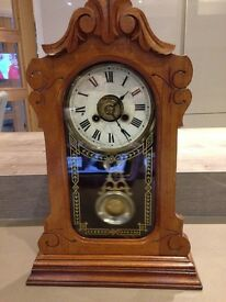 Jerome and Co antique wooden mantle clock.