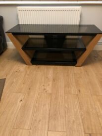 Wood and dark glass TV stand