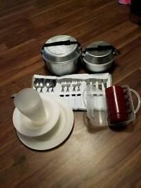 2 x pan sets, kettle, cup set, cutlery set, plates