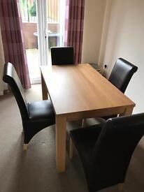 Lovely dining table and 4 chairs for sale