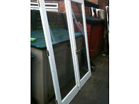 Exterior double doors with double glazed glass (slight misting on one panel)