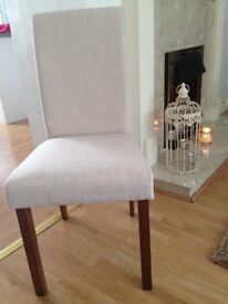 Dining chairs...brand new. 4 dining chairs.....still in box. Cream upholstery.