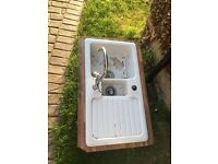 White ceramic sink and tap
