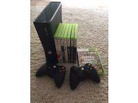 Xbox 360 slim - 2 wireless controllers - 8 games - GTA 5 , Skyrim , C.O.D
