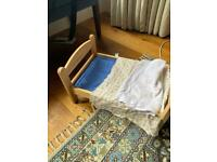 Wooden doll bed and blankets
