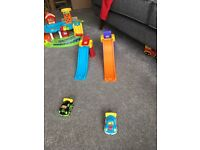 Vtech bundle- includes garage, police station, racing slides and numerous vechicles.