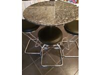 Solid marble dining table and 4 stools