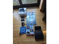 Mint Condition PS3 with 14 games also including PlayStation Move and uDraw controller