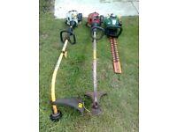 three petrol garden power tools