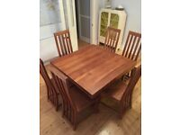 Beautiful mango wood dining room table and six chairs