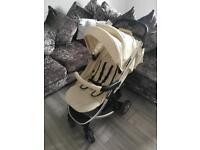 Lovely cream pushchair with change bag
