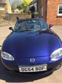Blue Mazda MX5, 1.8l, 99,600 miles, 12 month MOT, a bit tatty but drives a treat