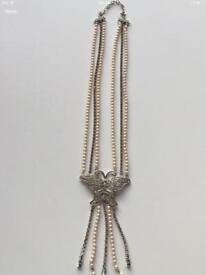 Diamond and Pearl Butterfly Necklace.