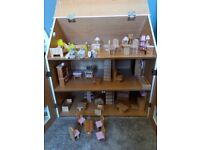 Wooden dolls house with lots of furniture