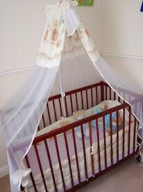 Baby's cot bed with mattress, canopy and bumper
