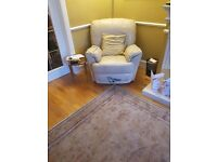 Cream coloured leather recliner chair