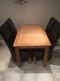Solid oak dining table and 4 real leather chairs