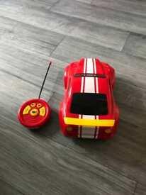 Remote control red sports car.