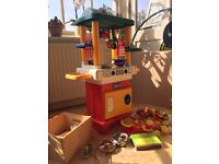 Chicco kids toy kitchen, with extra plastic food, pans, scales, cutlery & pretend money