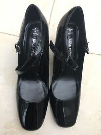 NEXT black patent court shoes with buckle strap. New.