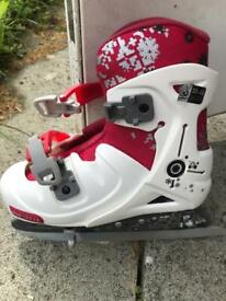 Adjustable unisex ice skates.