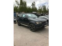 Black BMW X5, black wheels, good condition