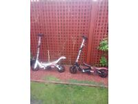 2 space scooters one black/red and one white/red used but good condition