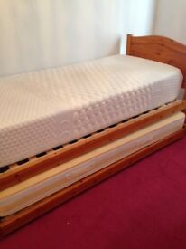 Single Guest Bed. Pine frame, roll out frame underneath. Without mattresses.