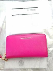 Michael kors travel smartphone wristlet . Brand new