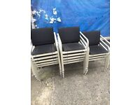 13 stackable chairs black and silver