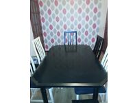 Leekes Extending black dining table and 6 chairs (black/off white) Seats recently recovered.