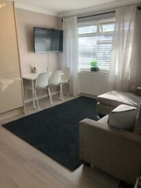 Top floor 2 bedroom Flat with open plan kitchen living room fully furnished close to transport links