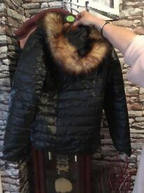 Black moncler type jacket with fur trim on hood