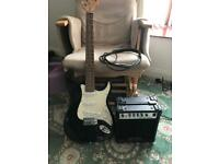 Squier Fender Strat, amp and lead included.
