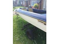 Speedboat with outboard and trailer