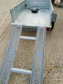 Trailer with fixed folding ramp