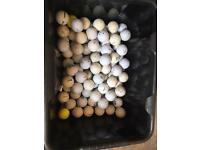 127 mixed golf balls.