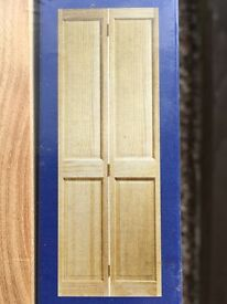 Bi Folding Pine Doors. Still in original packaging. Never fitted. A fraction of current price.