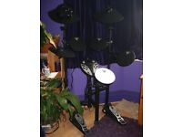 Tourtech electronic drumkit with headphones and sticks