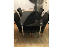 Black glass dining table and 4 X chairs