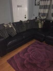 Purple leather and fabric corner sofa