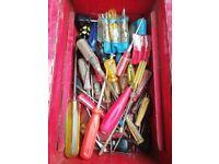 various screwdrivers in metal tool box