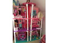 Barbie Dream house with vintage car, horse and cart, dolls, closet and clothes
