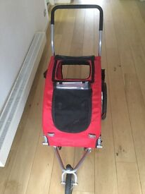 Trixie Minou Cuddly Cave, Medium Dog Stroller. Used once. 45x48x74cm. Jogger and bike attachment.