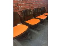 A set of four 1970's retro stacking chairs